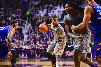 (Photo by Parker Robb | Collegian)  Freshman guard Marcus Foster looks for a foray into the front court in the second half of K-State's 85-82 overtime upset victory over the #7-ranked Jayhawks in the 279th Sunflower Showdown February 10, 2014, in Bramlage Coliseum. (Photo by Emily DeShazer | The Collegian)