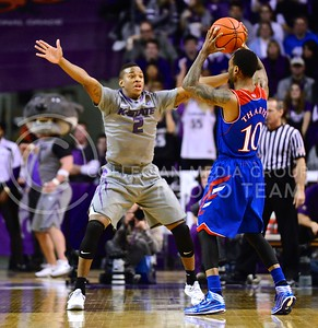 (Photo by Parker Robb | Collegian)  Freshman guard Marcus Foster guards against a pass from Kansas junior guard Naadir Tharpe in the second half of K-State's 85-82 overtime upset victory over the #7-ranked Jayhawks in the 279th Sunflower Showdown February 10, 2014, in Bramlage Coliseum. (Photo by Emily DeShazer | The Collegian)