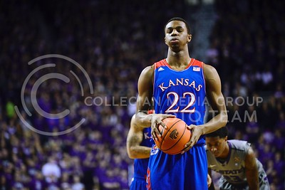 (Photo by Parker Robb | Collegian)  Kansas freshman guard Andrew Wiggins takes a deep breath to calm his nerves before releasing a free throw in the first half of K-State's 85-82 overtime upset victory over the #7-ranked Jayhawks in the 279th Sunflower Showdown February 10, 2014, in Bramlage Coliseum. (Photo by Emily DeShazer | The Collegian)