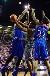 (Photo by Parker Robb | Collegian)  Senior guard Omari Lawrence is swarmed by Kansas' freshman forward Andrew Wiggins and senior forward Tarik Black as he attempts to take a shot in the second half of K-State's 85-82 overtime upset victory over the #7-ranked Jayhawks in the 279th Sunflower Showdown February 10, 2014, in Bramlage Coliseum. (Photo by Emily DeShazer | The Collegian)