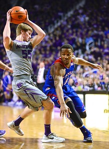 (Photo by Parker Robb | Collegian)  Senior guard Will Spradling keeps the ball away from Kansas freshman guard Wayne Selden, Jr., in the first half of K-State's 85-82 overtime upset victory over the #7-ranked Jayhawks in the 279th Sunflower Showdown February 10, 2014, in Bramlage Coliseum. (Photo by Emily DeShazer | The Collegian)