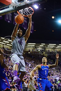 (Photo by Parker Robb | Collegian)  Junior forward Thomas Gipson takes a dunk against Kansas in the second half of K-State's 85-82 overtime upset victory over the #7-ranked Jayhawks in the 279th Sunflower Showdown February 10, 2014, in Bramlage Coliseum. (Photo by Emily DeShazer | The Collegian)