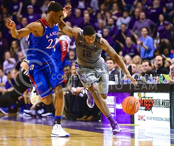 (Photo by Parker Robb | Collegian)  Senior guard Omari Lawrence brings the ball up court around Kansas freshman forward Andrew Wiggins in the second half of K-State's 85-82 overtime upset victory over the #7-ranked Jayhawks in the 279th Sunflower Showdown February 10, 2014, in Bramlage Coliseum. (Photo by Emily DeShazer | The Collegian)