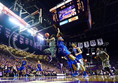 (Photo by Parker Robb | Collegian)  Freshman guard Nigel Johnson rises to the occasion and scores a layup in the midst of over 12,000 fans in the second half of K-State's 85-82 overtime upset victory over the #7-ranked Jayhawks in the 279th Sunflower Showdown February 10, 2014, in Bramlage Coliseum. (Photo by Emily DeShazer | The Collegian)