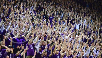 (Photo by Parker Robb | Collegian)  K-State students hold up three fingers on each hand after a Marcus Foster three-pointer in the second half of K-State's 85-82 overtime upset victory over the #7-ranked Jayhawks in the 279th Sunflower Showdown February 10, 2014, in Bramlage Coliseum. (Photo by Emily DeShazer | The Collegian)