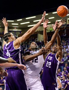 Photo by Parker Robb | Collegian  Senior guard Omari Lawrence sneaks past TCU forward Amric Fields (4) and guard Jarvis Ray (22) for a layup in the first half of K-State's 65-53 victory over the Horned Frogs February 19, 2014,  in Bramlage Coliseum.