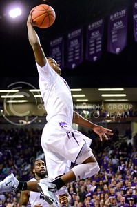 Photo by Parker Robb | Collegian  Freshman guard Marcus Foster scores a breakaway dunk in the first half of K-State's 65-53 victory over the Horned Frogs February 19, 2014,  in Bramlage Coliseum.