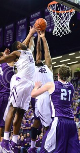 Photo by Parker Robb | Collegian  Senior guard Omari Lawrence (12) and junior forward Thomas Gipson reach for a rebound against TCU in the first half of K-State's 65-53 victory over the Horned Frogs February 19, 2014,  in Bramlage Coliseum.