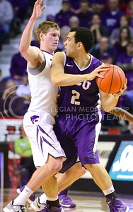 Photo by Parker Robb | Collegian  Senior guard Will Spradling prevents TCU guard Michael Williams from getting to the basket in the first half of K-State's 65-53 victory over the Horned Frogs February 19, 2014,  in Bramlage Coliseum.