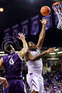 Photo by Parker Robb | Collegian  Junior forward Thomas Gipson scores a layup in the first half of K-State's 65-53 victory over the Horned Frogs February 19, 2014,  in Bramlage Coliseum. Gipson led the Wildcats against TCU with 16 points.