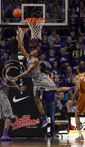 (Photo by Taylor Alderman | Collegian)   Wesley Iwundu, freshman forward, jumps for two during the game against Texas at Bramlage Coliseum. K-State beat Texas 74-57 on February 8, 2014.