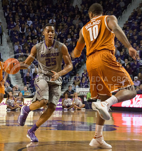 (Photo by Taylor Alderman | Collegian)   Wesley Iwundu, freshman forward, looks past Texas forward, Johnathan Holmes, at Bramlage Coliseum. Iwundu had eight points against the Longhorns on February 8, 2014.