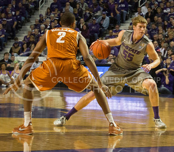 (Photo by Taylor Alderman | Collegian)   Will Spradling, senior guard, pivots away from Demarcus Holland in the game against Texas at Bramlage Coliseum. K-State defeated Texas 74-57 on February 8, 2014.