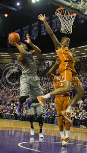 (Photo by Taylor Alderman | Collegian)   Nino Williams, junior forward, goes for two while avoiding Demarcus Holland and Isaiah Taylor at Bramlage Coliseum. K-State defeated Texas 74-57 on February 8, 2014.