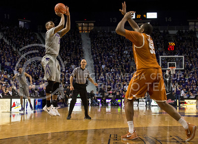 (Photo by Taylor Alderman | Collegian)   Marcus Foster, freshman guard, in the air to score a three-pointer as Cameron Ridley runs to defend him. Foster had thirty-four points against the Longhorns at Bramlage Coliseum on February 8, 2014.