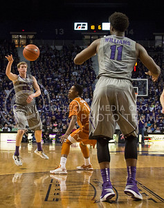 (Photo by Taylor Alderman | Collegian)   Will Spradling, senior guard, passes the ball to Nino Williams, junior forward during the game against Texas. The Wildcats beat the Longhorns 74-57 on February 8, 2014 at Bramlage Coliseum.