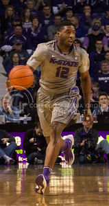 (Photo by Taylor Alderman | Collegian)   Omari Lawrence, senior guard, dribbles the ball down the court at Bramlage Coliseum. K-State defeated Texas 74-57 on February 8, 2014.