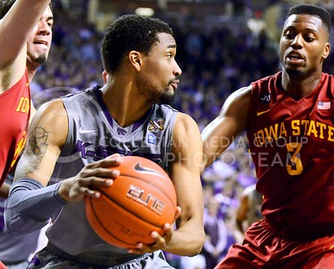 Photo by Parker Robb | Collegian  Senior forward Shane Southwell attempts to pass around Iowa State forward Melvin Ejim to a teammate on the outside of the arc in the second half of the Wildcats' 80-73 victory over the #15-ranked Cyclones Saturday evening in Bramlage Coliseum. Southwell led the Wildcats with 13 points, including four from beyond the arc.