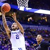 Parker Robb | The Collegian<br /> <br /> Kentucky freshman guard Aaron Harrison circumvents K-State freshman forward Marcus Foster and goes for a layup in the second half of the Kentucky Wildcats' victory over the K-State Wildcats in the NCAA Tournament Second Round in St. Louis March 21, 2014.