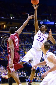 Parker Robb | The Collegian  Star KU freshman guard Andrew Wiggins shoots a floater above the head of Eastern Kentucky's Marcus Lewis in the first half of the Jayhawks' defeat of the Colonels in the Second Round of the NCAA Tournament March 21, 2013, in St. Louis. Wiggins declared for the NBA draft March 31 after only a single year at KU.