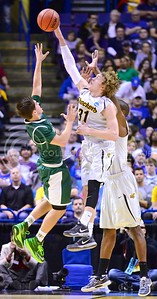 Parker Robb | The Collegian  Wichita State guard Ron Baker blocks a shot put up by Cal Poly's Ridge Shipley in the second half of the Shocker's NCAA tournament second-round defeat of the Mustangs March 21, 2014, at the Scottrade Center in St. Louis.