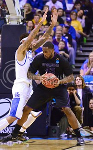 Parker Robb | The Collegian  Junior forward Thomas Gipson attempts to advance past the impenetrable Kentucky forward Willie Cauley-Stein for a basket in the second half of K-State's 56-49 second-round NCAA tournament loss at the hands of Kentucky March 21, 2014, at the Scottrade Center in St. Louis.