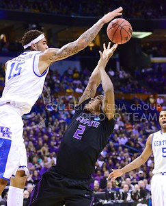Parker Robb | The Collegian  Freshman forward Marcus Foster is blocked by Kentucky forward Willie Cauley-Stein as he attempts to take a shot in the first half of the K-State Wildcats' 56-49 NCAA Second Round loss to the Kentucky Wildcats Friday night at the Scottrade Center in St. Louis. Foster's team-leading 15 points weren't enough to overcome Kentucky's 7 blocks, including 4 from Cauley-Stein.