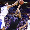 Parker Robb | The Collegian<br /> <br /> Freshman forward Marcus Foster is blocked by Kentucky forward Willie Cauley-Stein as he attempts to take a shot in the first half of the K-State Wildcats' 56-49 NCAA Second Round loss to the Kentucky Wildcats Friday night at the Scottrade Center in St. Louis. Foster's team-leading 15 points weren't enough to overcome Kentucky's 7 blocks, including 4 from Cauley-Stein.