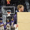 Josh Staab // The Collegian  Senior guard Will Spradling smiles as he carries his framed jersey across the court before the start of Saturday's senior night game against Baylor. Spradling was one of the four K-State Seniors to display his jersey to the stadium with his family.