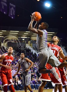 (Photo by Parker Robb | Collegian)  Freshman guard Jevon Thomas flies toward the basket as other players look on during the second half of the Wildcats' 72-66 victory over the #25 Oklahoma Sooners January 14, 2014, in Bramlage Coliseum.