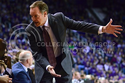 (Photo by Parker Robb | Collegian)  Oklahoma head coach Lon Kruger ushers to the court while instructing players on his bench during the first half of the Wildcats' 72-66 victory over the #25 Oklahoma Sooners January 14, 2014, in Bramlage Coliseum. Kruger played at K-State in college, and was the head coach from 1986-90, leading K-State to the Elite Eight in 1988. He has been the head coach at OU since 2011.