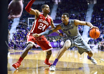 (Photo by Parker Robb | Collegian)  Senior guard Shane Southwell attempts to maneuver past Oklahoma guard Buddy Hield during the second half of the Wildcats' 72-66 victory over the #25 Oklahoma Sooners January 14, 2014, in Bramlage Coliseum.