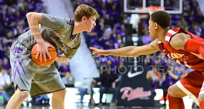 (Photo by Parker Robb | Collegian)  Senior guard Will Spradling keeps the ball away from an Oklahoma defender during the first half of the Wildcats' 72-66 victory over the #25 Oklahoma Sooners January 14, 2014, in Bramlage Coliseum.