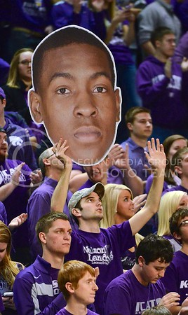 (Photo by Parker Robb | Collegian)  A K-State student holds up a cardboard cutout of freshman forward Wesley Iwundu's head during the second half of the Wildcats' 72-66 victory over the #25 Oklahoma Sooners January 14, 2014, in Bramlage Coliseum. Iwundu finished the game with 11 points and 3 of 3 from beyond the arc.