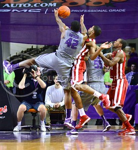 (Photo by Parker Robb | Collegian)  Junior forward Thomas Gipson battles two Oklahoma players for a rebound during the second half of the Wildcats' 72-66 victory over the #25 Oklahoma Sooners January 14, 2014, in Bramlage Coliseum.