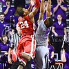 Photo by Parker Robb | The Collegian  Oklahoma guard Buddy Hield puts up a floater above freshman guard Marcus Foster during the second half of the Wildcats' 72-66 victory over the #25 Oklahoma Sooners January 14, 2014, in Bramlage Coliseum.
