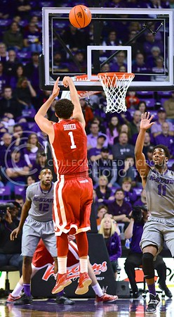 (Photo by Parker Robb | Collegian)  Oklahoma guard Frank Booker attempts a three-pointer as junior forward Nino Williams rushes to defend during the first half of the Wildcats' 72-66 victory over the #25 Oklahoma Sooners January 14, 2014, in Bramlage Coliseum.