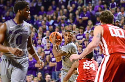 (Photo by Parker Robb | Collegian)  Freshman forward Marcus Foster looks to pass the ball past two Oklahoma defenders to Junior forward Nino Williams during the first half of the Wildcats' 72-66 victory over the #25 Oklahoma Sooners January 14, 2014, in Bramlage Coliseum.