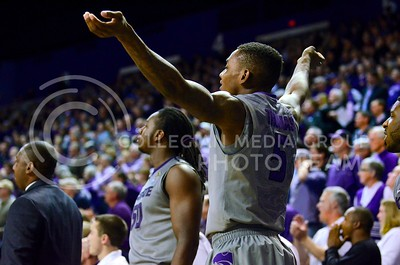 (Photo by Parker Robb | Collegian)  Freshman guard Jevon Thomas ushers for the crowd to get louder during waning moments of the second half of the Wildcats' 72-66 victory over the #25 Oklahoma Sooners January 14, 2014, in Bramlage Coliseum. The Wildcats fell behind the Sooners 62-56 with about six minutes remaining, but managed to come back and win with a 16-4 run to end it.