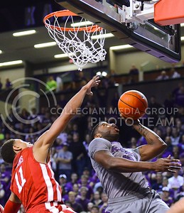 (Photo by Parker Robb | Collegian)  Senior guard Omari Lawrence attempts a layup before Oklahoma guard Isaiah Cousins can get an arm in the way during the first half of the Wildcats' 72-66 victory over the #25 Oklahoma Sooners January 14, 2014, in Bramlage Coliseum.