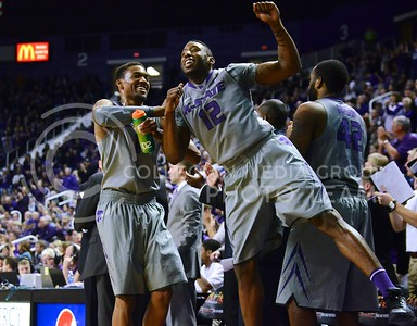 (Photo by Parker Robb | Collegian)  Senior guard Shane Southwell and senior guard Omari Lawrence celebrate after an Oklahoma turnover midway through the second half of the Wildcats' 72-66 victory over the #25 Oklahoma Sooners January 14, 2014, in Bramlage Coliseum.