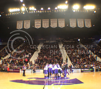 (Photo by Chandler Riley | The Collegian)  The Women's basketball team huddles up before their scrimmage at Madness in Manhattan on Friday night in Bramlage Coliseum.