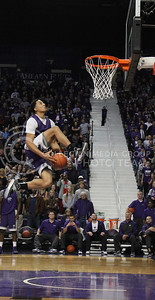 (Photo by Chandler Riley | The Collegian)  Guard Justin Edwards brings the ball between his legs while on his way up for a dunk during the dunk contest Friday night in Bramlage Coliseum.