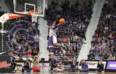 Taylor Alderman | The Collegian  Freshman guard Justin Edwards leaps for a dunk during the dunk contest at Madness in Manhattan at Bramlage Coliseum on Friday Oct. 25, 2013. Madness in Manhattan was an event held to tip off the basketball season.