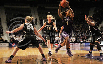 Taylor Alderman | The Collegian  Junior guard Haley Texada cuts across her teammates during the scrimmage at Madness in Manhattan at Bramlage Coliseum on Friday Oct. 25, 2013. The women's basketball team begins their season with an exhibition game against Washburn University.