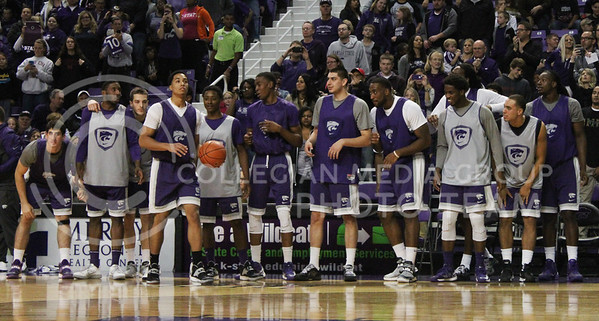 (Photo by Chandler Riley   The Collegian)  The Men's basketball team gets on their feet for Justin Edwards' last dunk of the dunk contest during Madness in Manhattan Friday night. Edwards surprised fans and got them excited during his high-flying dunks.