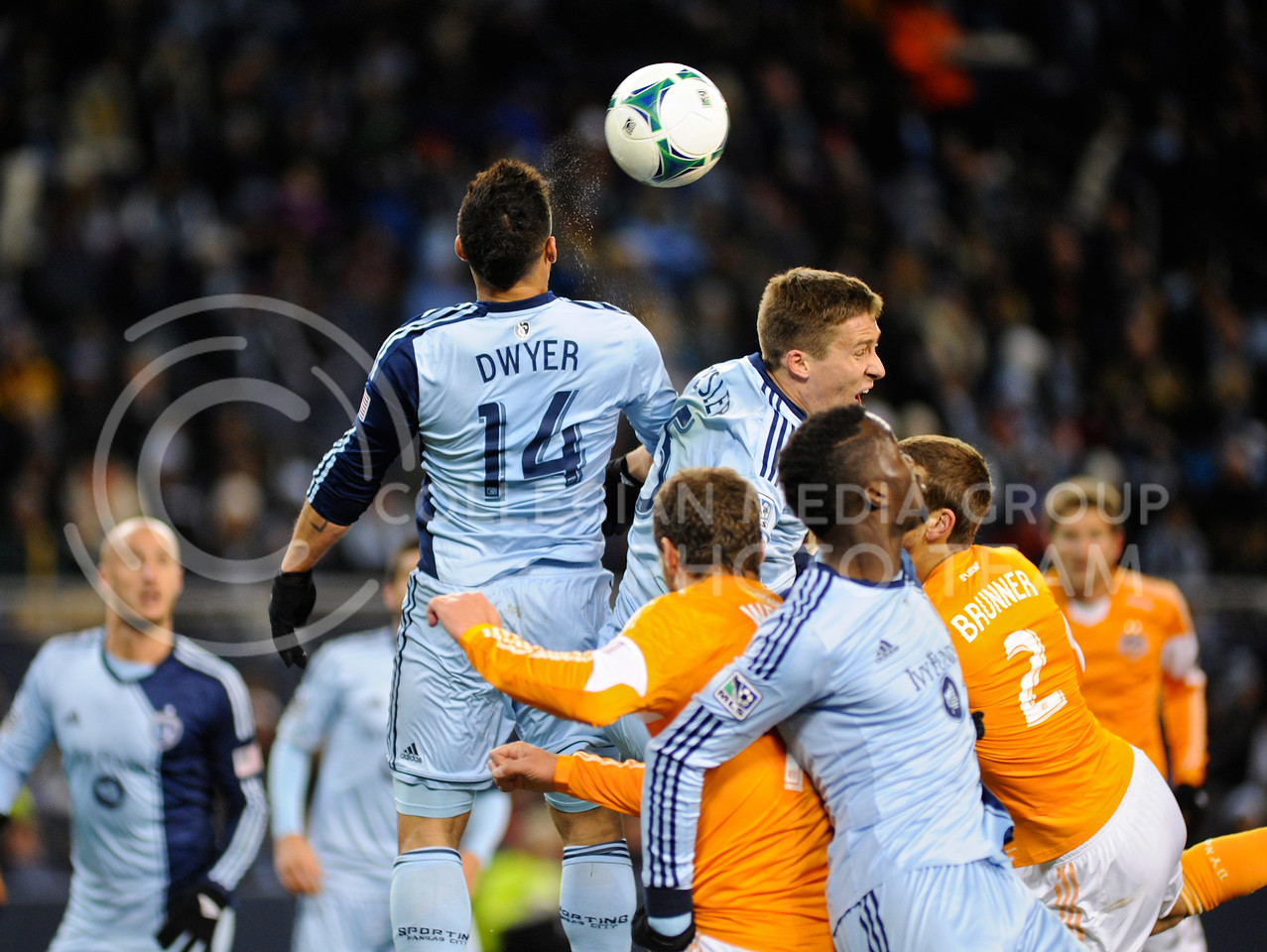 (Photo by Parker Robb | Collegian)<br /> <br /> Sporting KC and Houston Dynamo players battle for the ball as Sporting forward Dom Dwyer goes for a header during the MLS Eastern Conference championship game November 23 at Sporting Park, where Kansas City beat Houston 2-1. Sporting KC has had a championship-caliber season, amassing a 17-10-7 record, most recently avenging the club's two losses to Houston in the Eastern Conference championship games the previous two years, and now hosting the MLS Cup on December 7.
