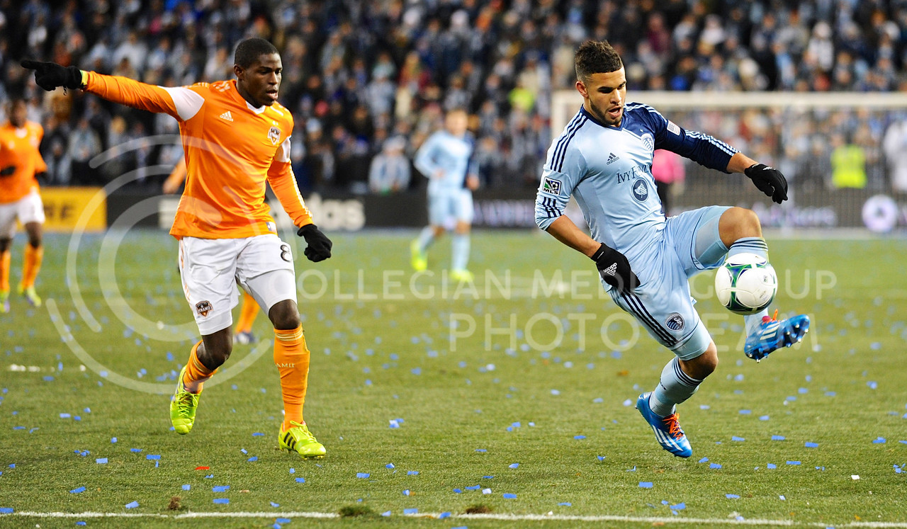 (Photo by Parker Robb | Collegian)<br /> <br /> Sporting KC forward Dom Dwyer finesses the ball around Houston Dynamo defender Kofie Sarkodie during the MLS Eastern Conference championship game November 23 at Sporting Park, where Kansas City beat Houston 2-1. Sporting KC has had a championship-caliber season, amassing a 17-10-7 record, most recently avenging the club's two losses to Houston in the Eastern Conference championship games the previous two years, and now hosting the MLS Cup on December 7.