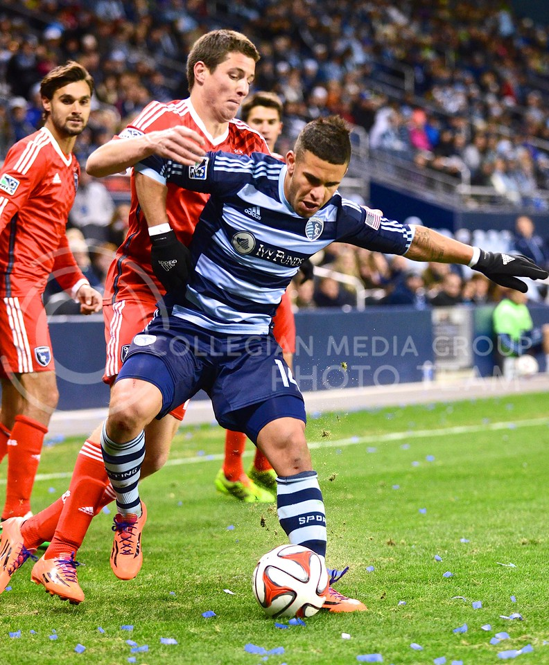 (Photo by Parker Robb | Collegian)<br /> <br /> Sporting Kansas City forward Dom Dwyer (blue) aggressively advances past San Jose midfielder J.J. Koval and his attempts at stealing the ball in the second half of Sporting's 1-0 win over the Earthquakes March 22, 2014, in Sporting Park. Dwyer scored a goal in each of Sporting's past two games.
