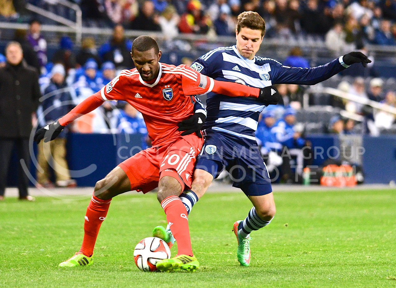 (Photo by Parker Robb | Collegian)<br /> <br /> Sporting Kansas City forward Sal Zizzo (blue) is fouled by San Jose defender Shaun Francis (red) as they battle for possession of the ball in the second half of Sporting's 1-0 win over the Earthquakes March 22, 2014, in Sporting Park. Zizzo had two assists in Sporting's 3-2 defeat of the Colorado Rapids Saturday in Denver.